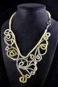 Many shades of yellow pearls and beads worked in freeform peyote stitches twist and turn into paisley shapes to create this lace-like neck piece.