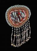 Journey with this fused glass set in a beaded cabochon and further embellished with beaded fringe.
